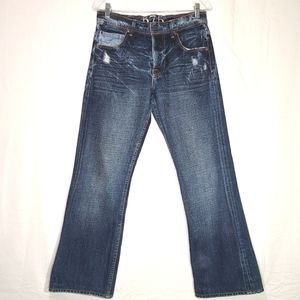 575 | Distressed Penny Button Fly Jeans